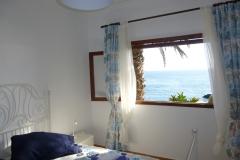 Schlafzimmer mit direktem Meerblick
